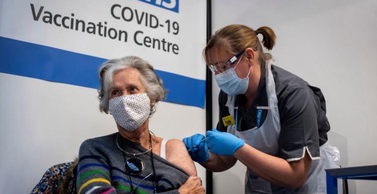 male receiving coronavirus vaccination