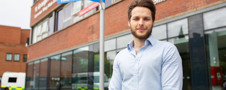 A man standing outside a hospital