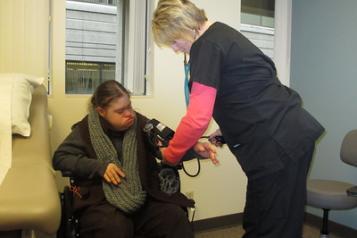 Image of nurse taking someone's blood pressure