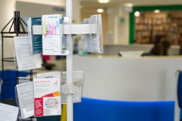 leaflets on a stand in a waiting room
