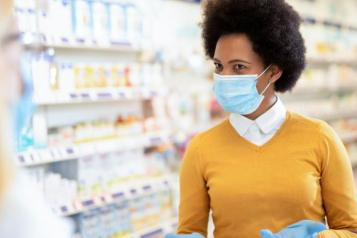 Photo of pharmacist wearing a mask