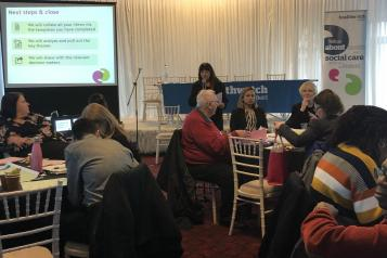 Healthwatch board member at a conference