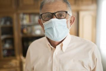 image of older male who is wearing a protective face mask