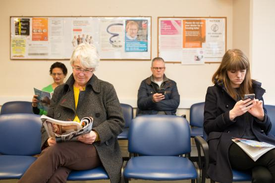 People in GP waiting room
